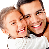 Father and daughter hugging for picture